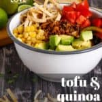 Pin for pinterest with front view of finished plant based taco salad. Text on top, tofu & quinoa taco salad