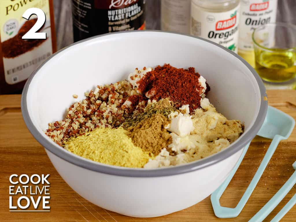 All the spices are shown on top of the tofu and quinoa to make the quinoa tofu taco meat.