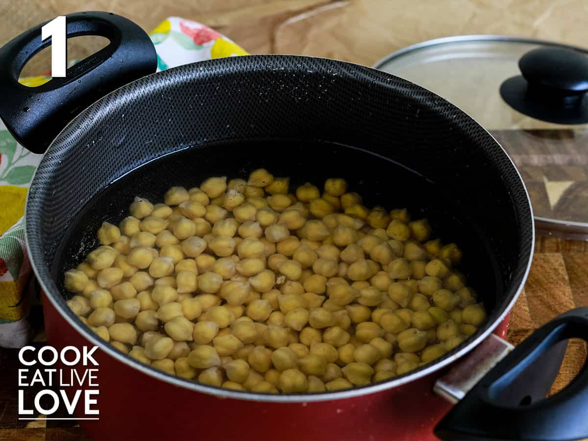 Chickpeas are in pot covered with water.