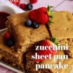 Pin for Pinterest with Stack of vegan sheet pan pancakes covered with berries.