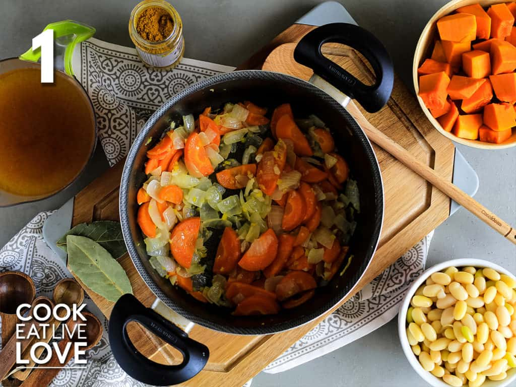 Vegetables are sauteed in a soup pot until tender.
