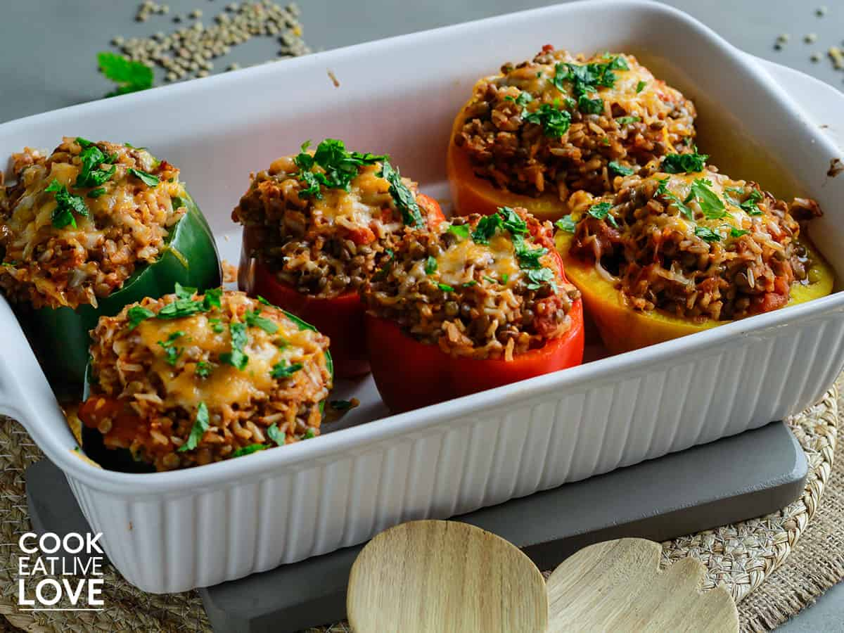 Cooked lentil stuffed peppers in a casserole dish