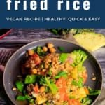Pin for Pinterest with plate serving up vegan pineapple fried rice.