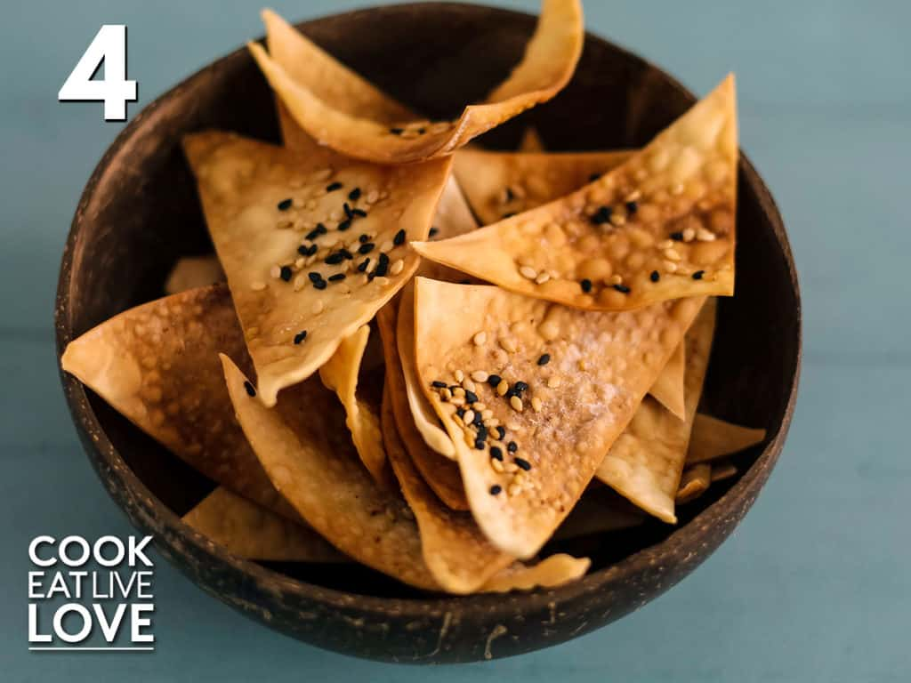 Overhead view of baked wonton crackers golden brown in a bowl.