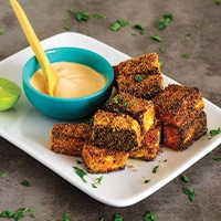 Crispy cornmeal breaded tofu with dipping sauce.