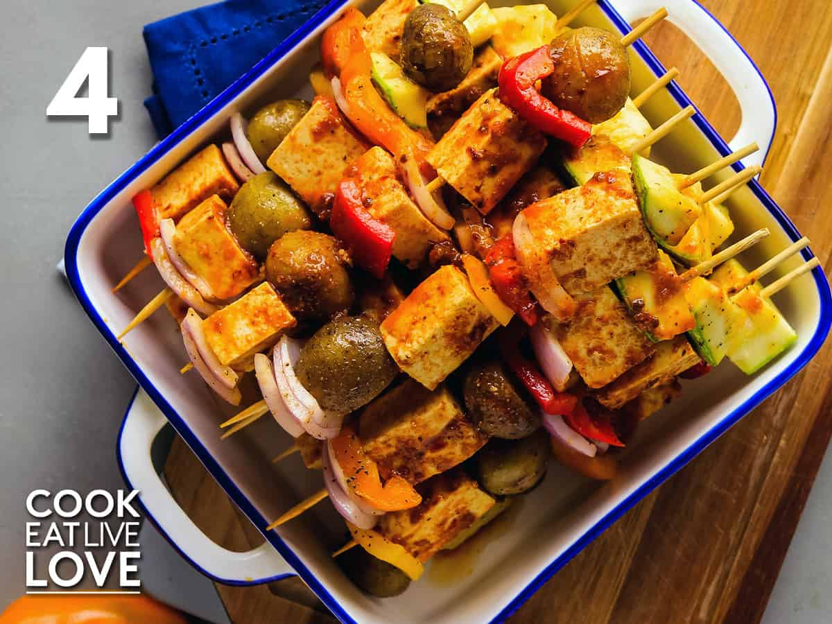 Vegetables and tofu are threaded onto skewers and ready for the grill.