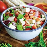 Front view of solterito salad in white bowl.