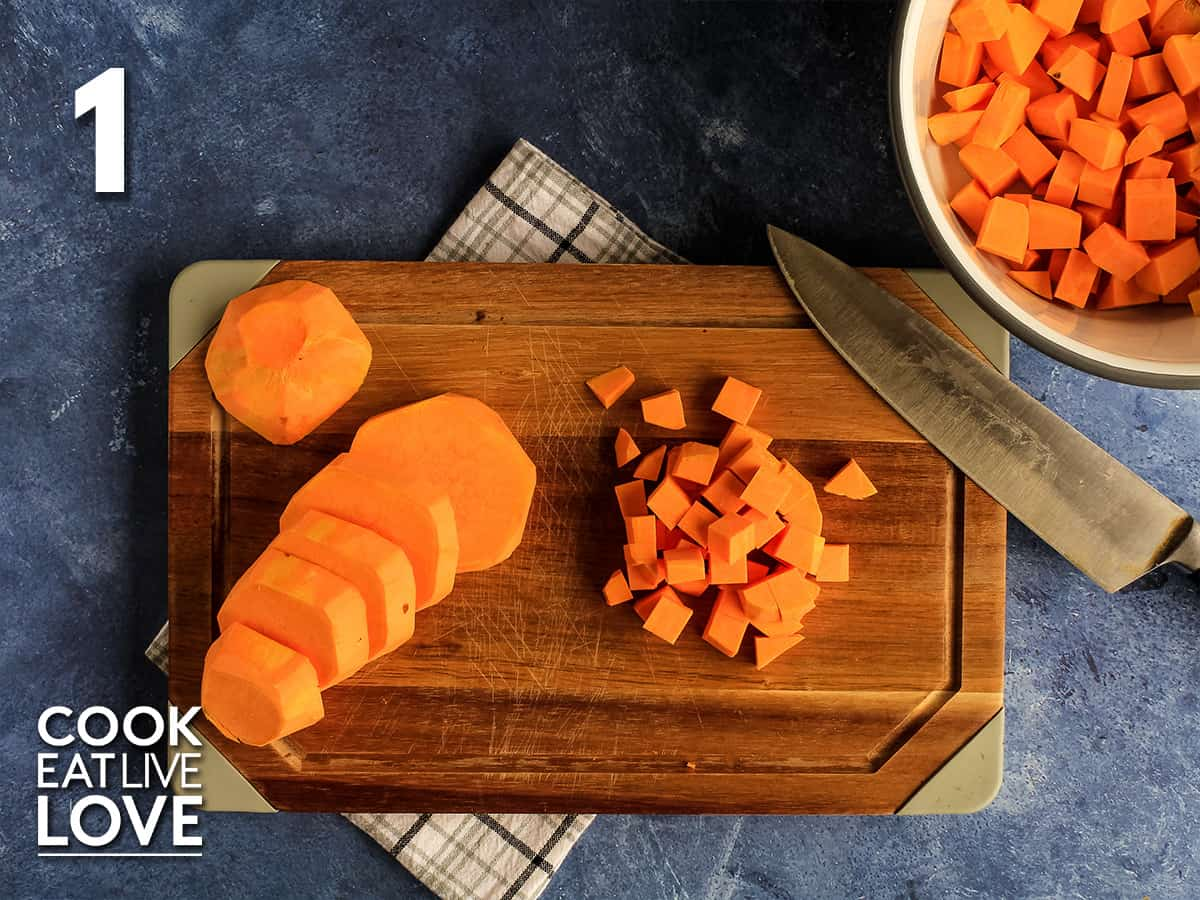 Sweet potato on cutting board cut to make sweet potato hash.