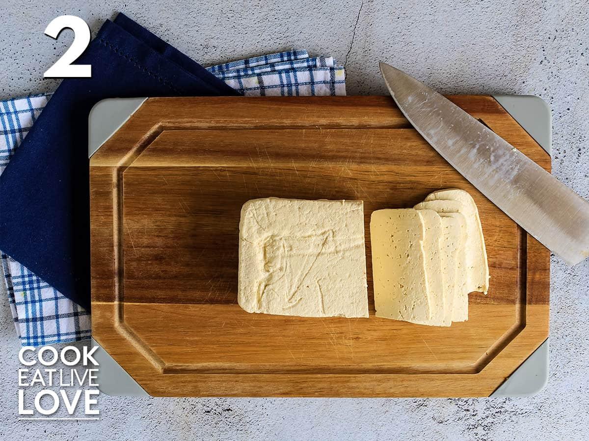Tofu on cutting board to make tofu blt.
