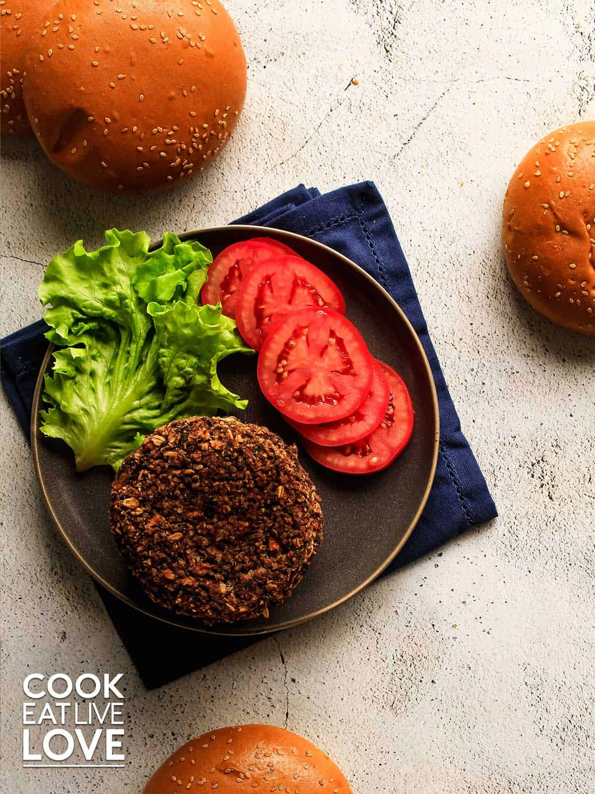 Overhead view of black bean quinoa burgers on a plate ready to build a burger.