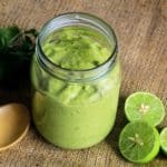 Close up overhead view of jar of creamy avocado sauce.