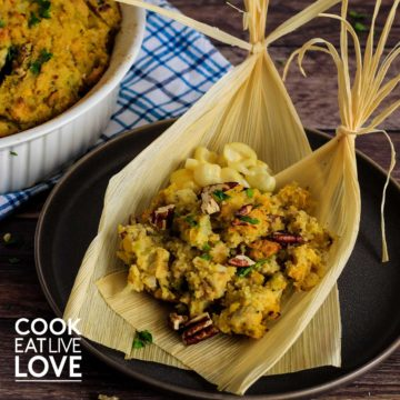 Corn husk on plate filled with gluten free cornbread stuffing.