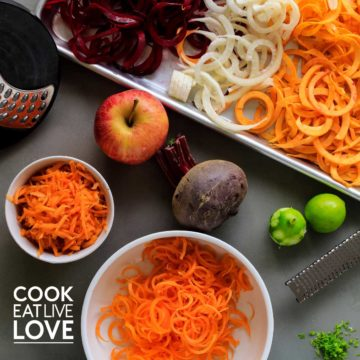 Different veggies cut and grated using a variety of kitchen cutting tools.