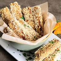 Panko crusted tofu sticks in bowl and on plate.