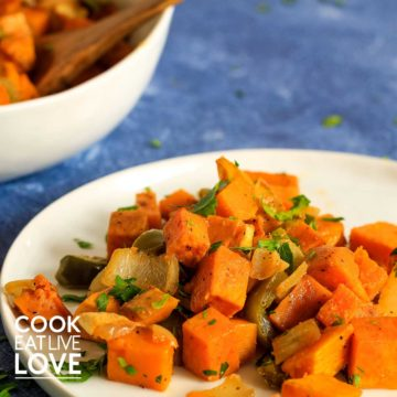 Vegetarian sweet potato hash served up on white plate.