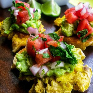 Tostones with guacamole and pico de gallo.