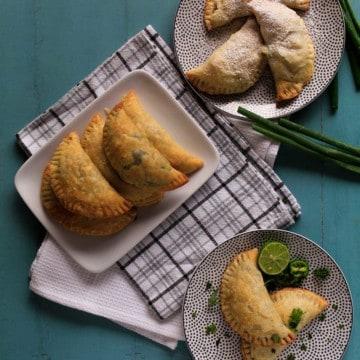 Overhead of baked vegetarian empanadas