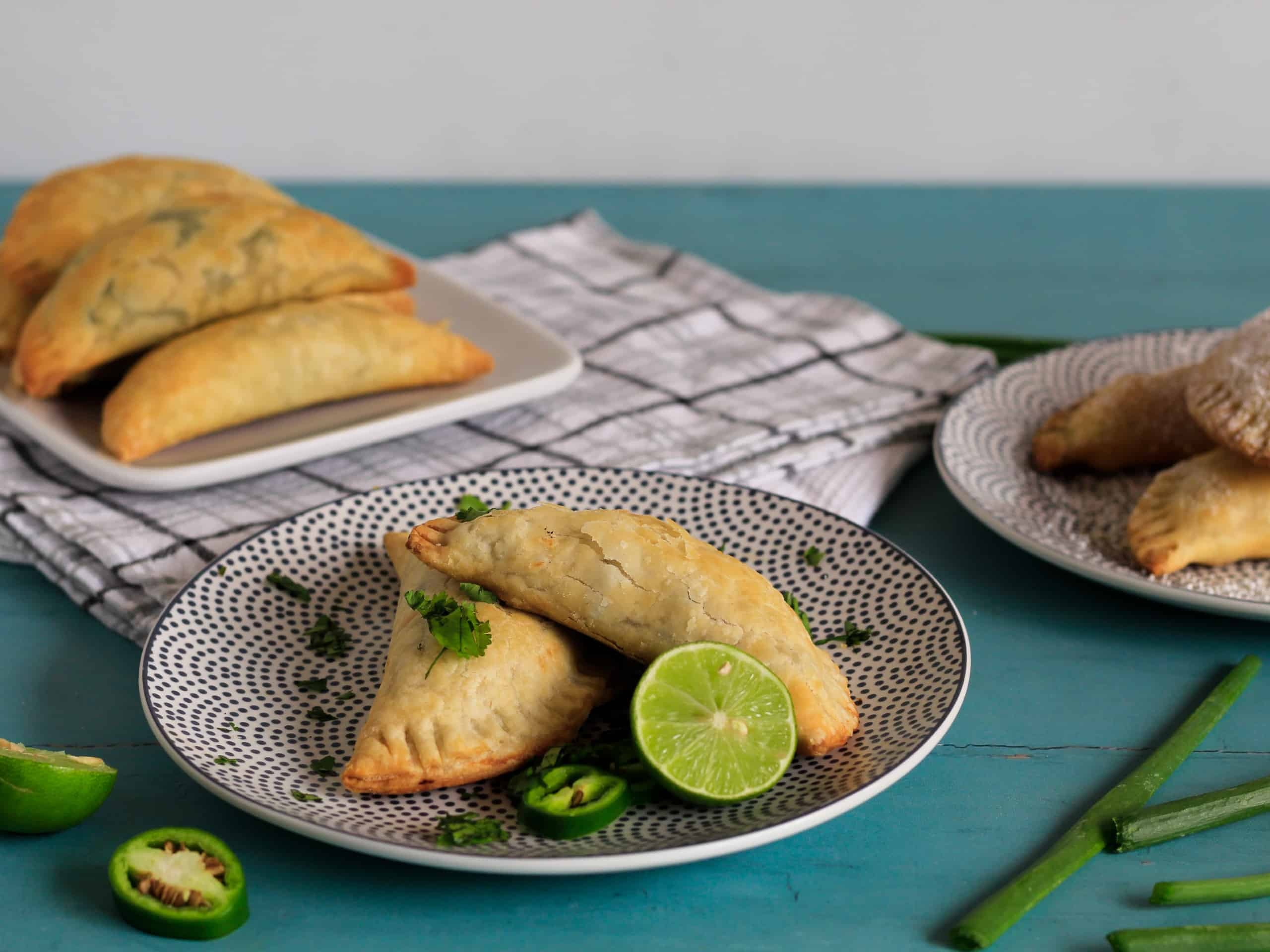 Plate with two cooked empanadas.