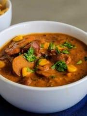 Closeup view of bowl of vegan potato corn chowder ready to eat.