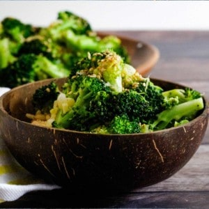 Broccoli in coconut bowl with sesame on top