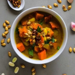 Overhead bowl of white bean and pumpkin soup