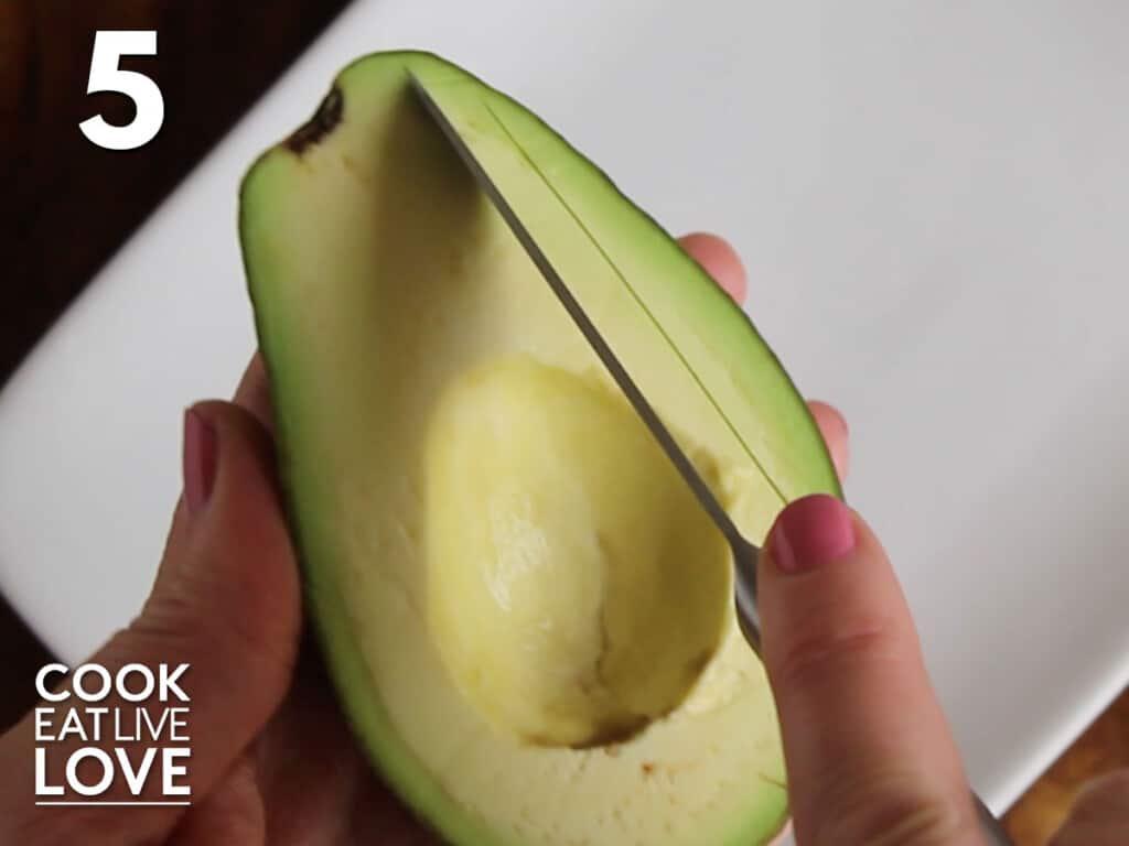 Slicing avocado in peel