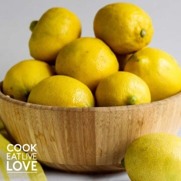 Wooden bowl piled with lemons