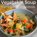 Pin for pinterest with photo of blue bowl filled with vegan vegetable soup.