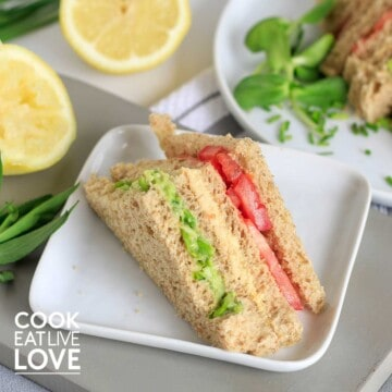 Vegan sandwich cut into triangle to show layers