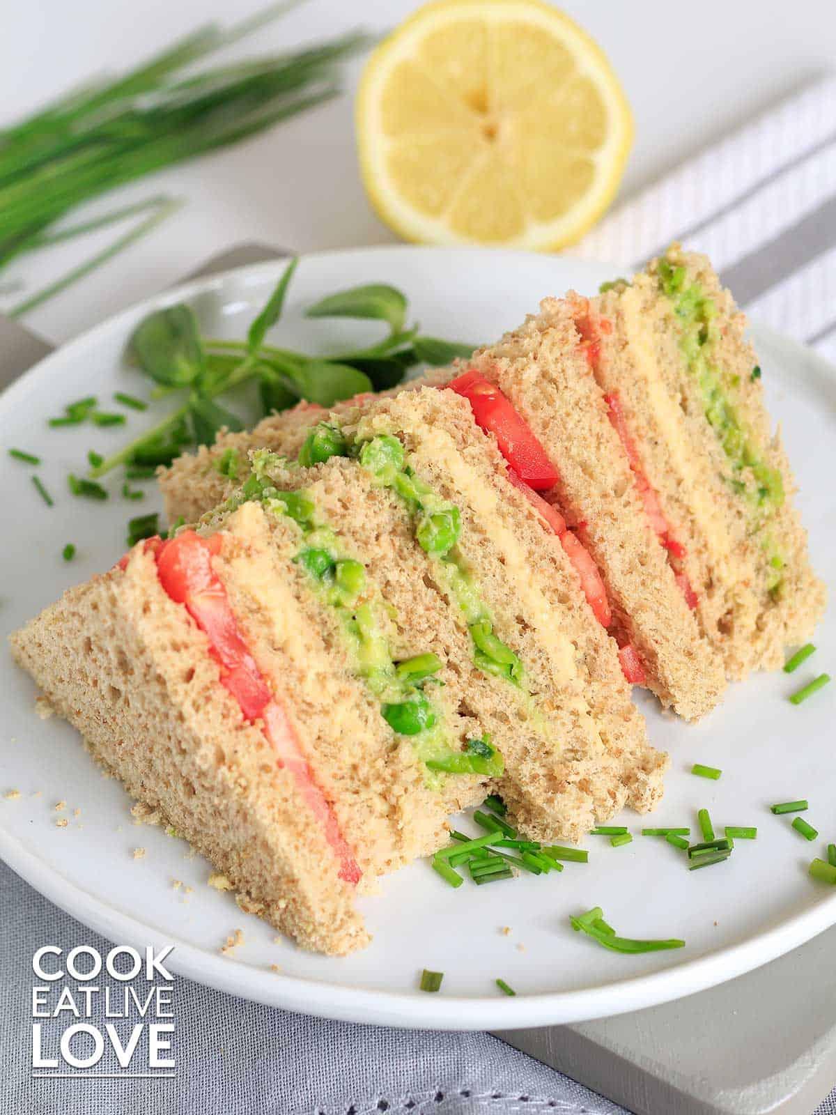 Vegan triple decker sandwich on a plate cut into triangles