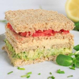 Ready to eat triple decker sandwich on a plate