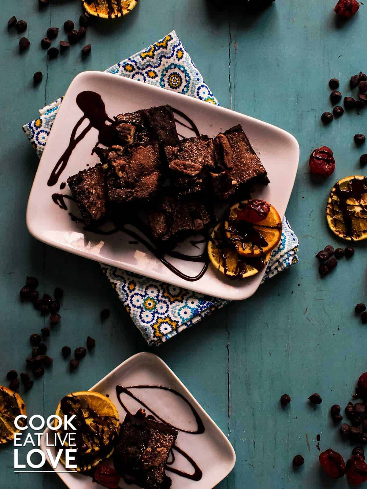 Brownies on plates with chocolate drizzle