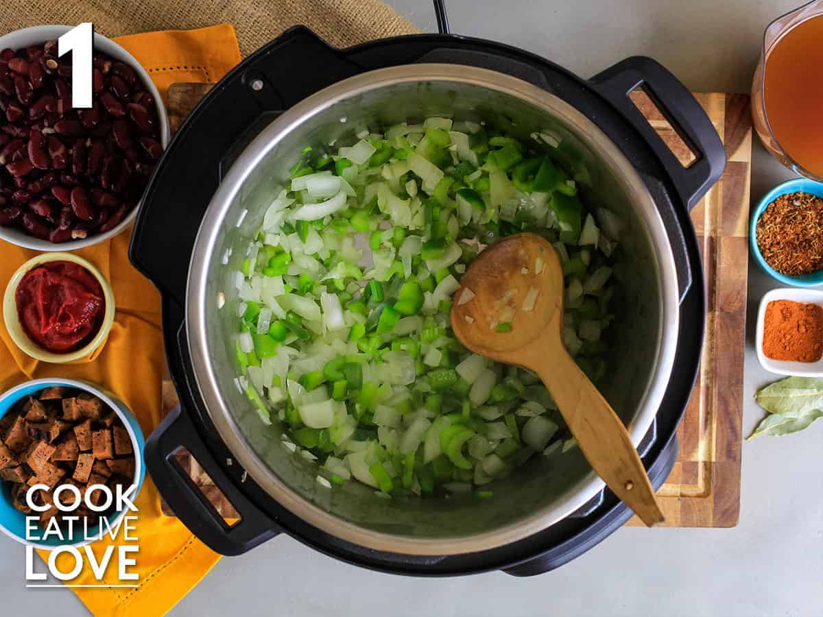 Onions, peppers and celery cooking in instant pot