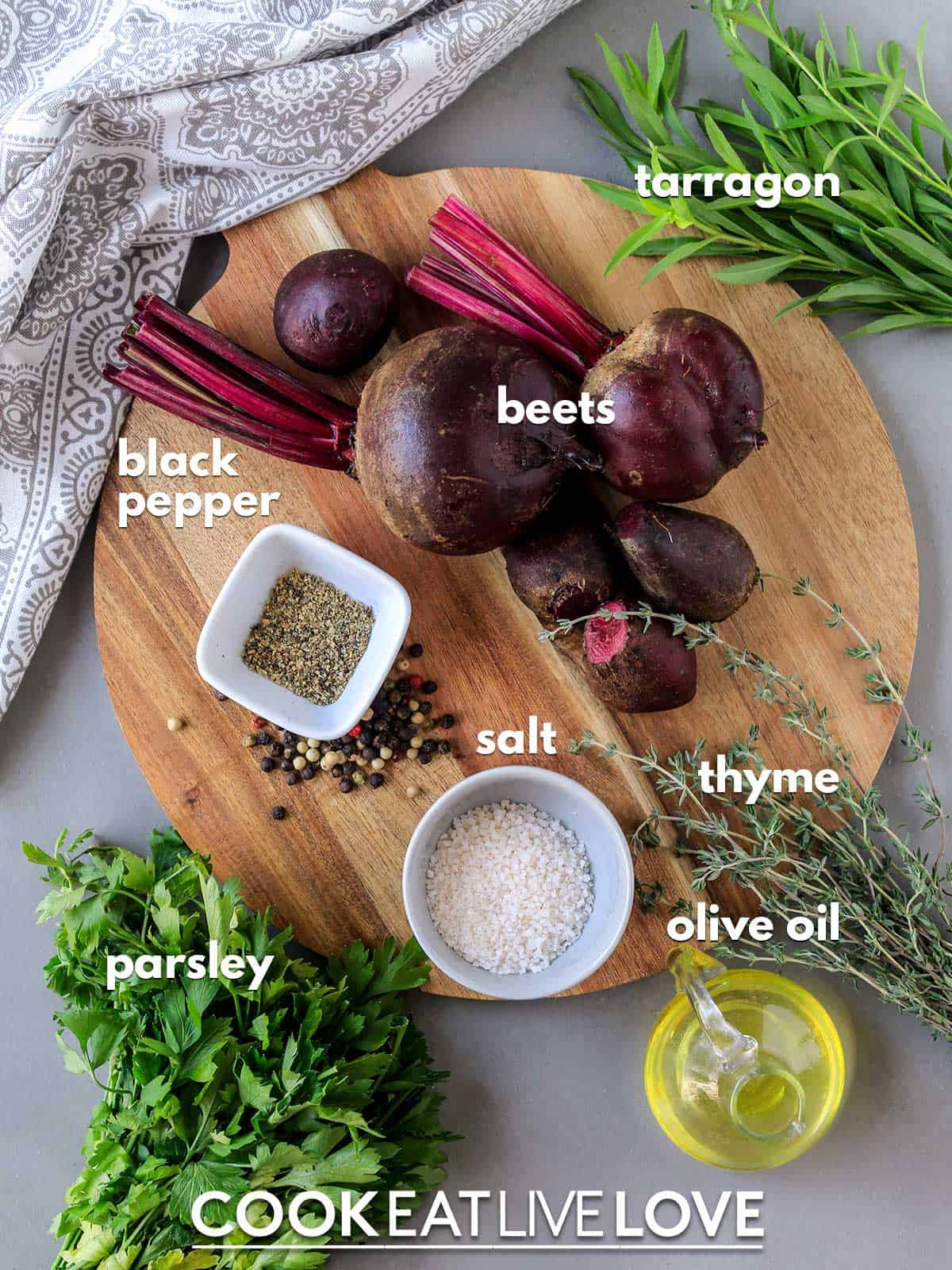 Ingredients to make roasted beets on the counter with text labels.