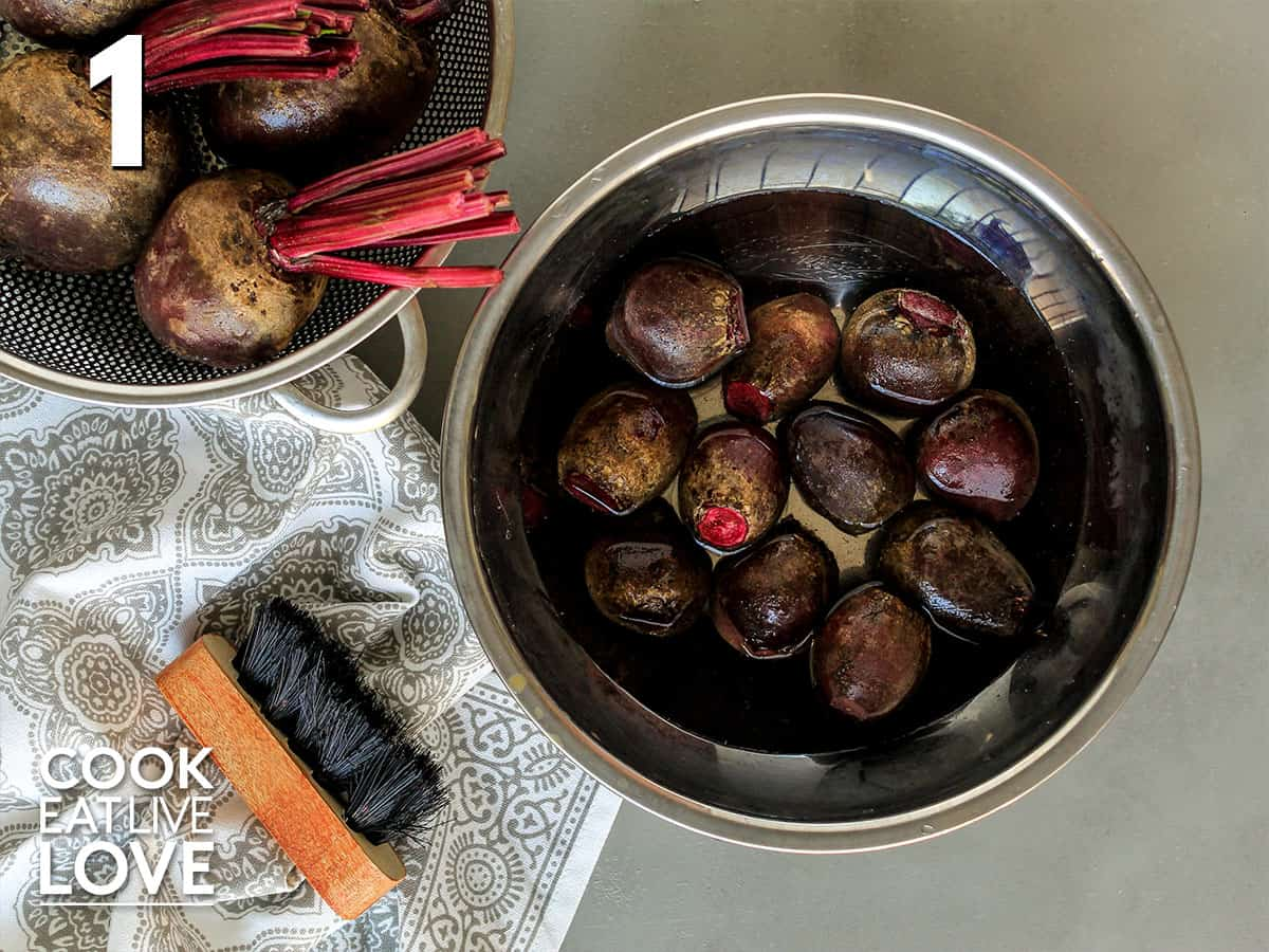 Beets in a strainer for cleaning