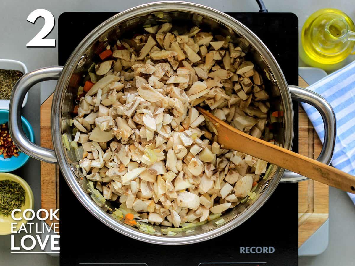 Mushrooms added to skillet on burner