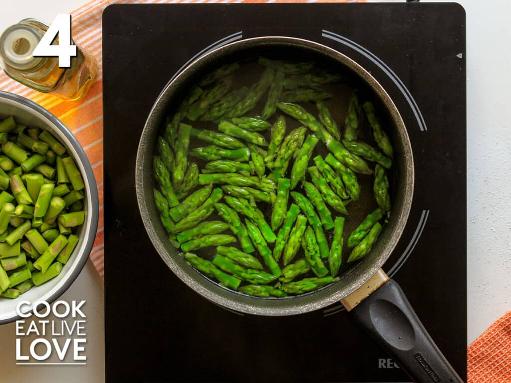 Asparagus in pot of hot water