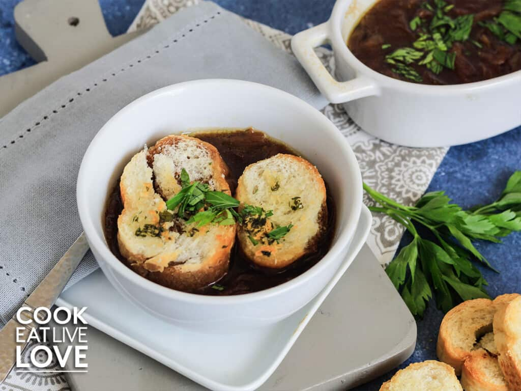 Bowl of soup topped with garlic croutons on a table