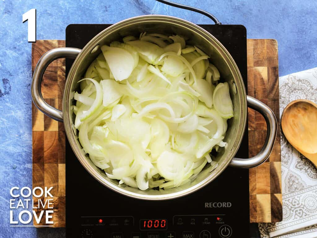 Onions beginning to saute in a pan