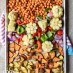 BBQ chickpeas and veggies cooked and ready on the sheet pan