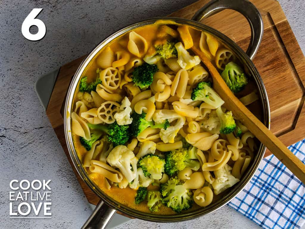 Cooked pasta and veggies are added to sauce