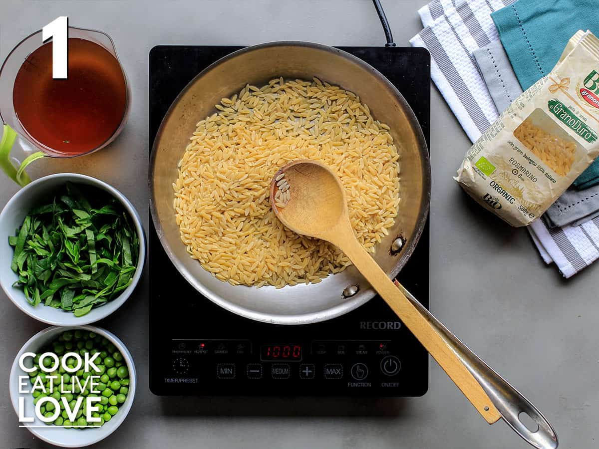 Orzo is toasting in the pan