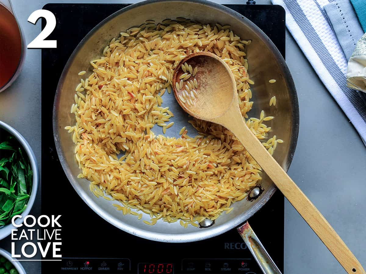 Lightly browned and toasted orzo in the pan