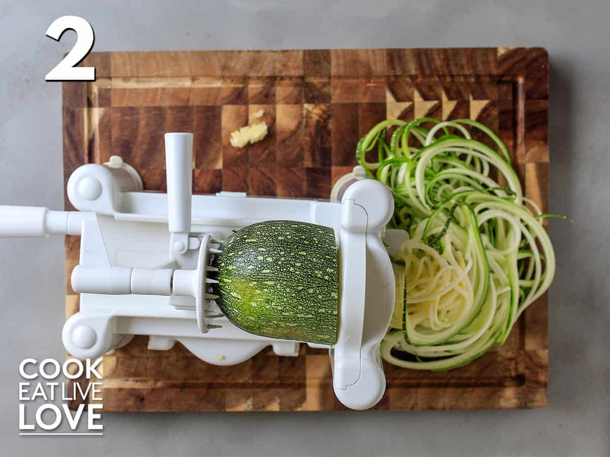 Zucchini in the spiralizer making zoodles