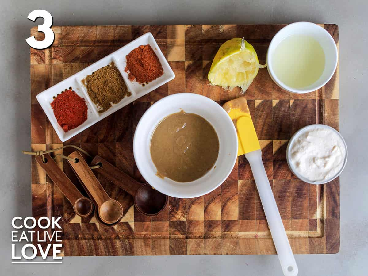 Tahini in a bowl on a cutting board to make the dressing