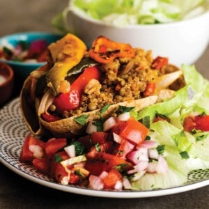 Vegetarian burrito bowls served up on a plate with toppings