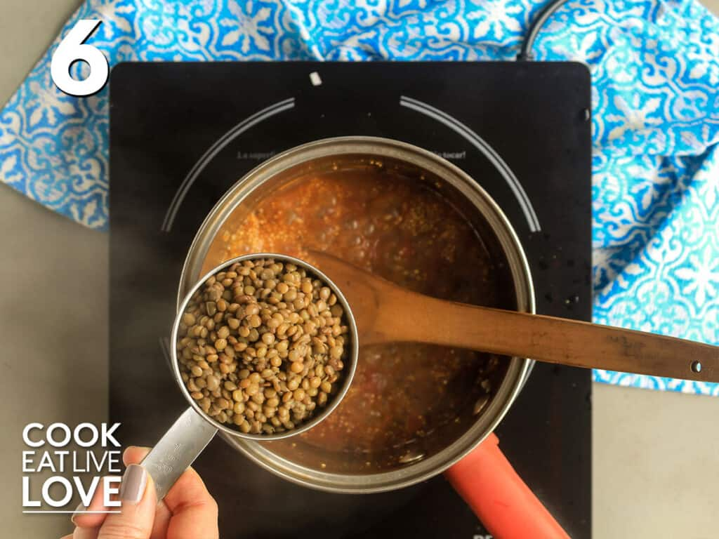 Adding lentils to the pot of cooking quinoa