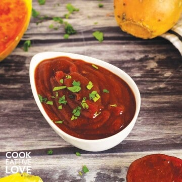 Spicy chipotle bbq sauce in a bowl with fruit