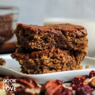 Two vegan blondies stacked on a plate