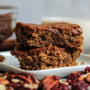 Two vegan blondies on a plate.